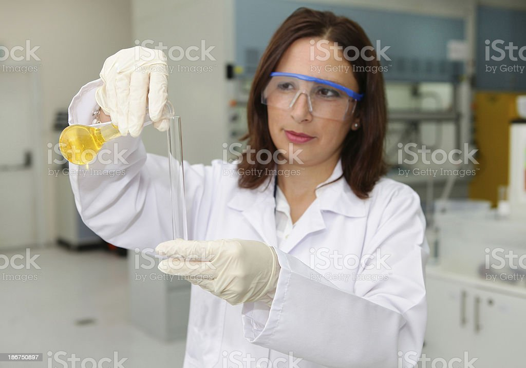 Woman in quality control lab royalty-free stock photo