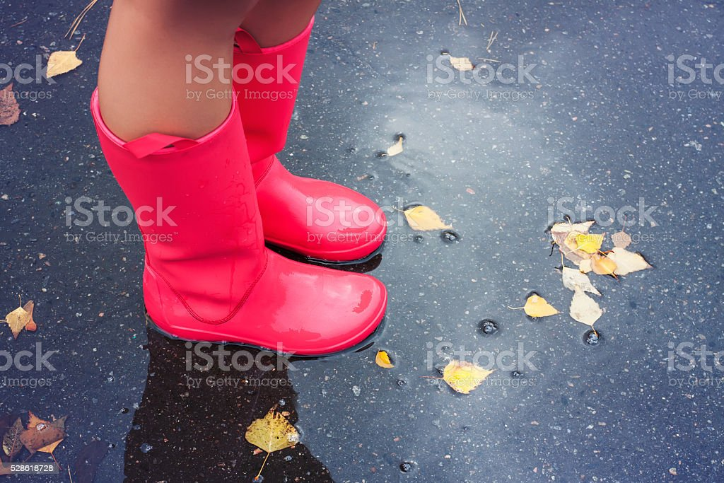 Woman in rain boots stock photo