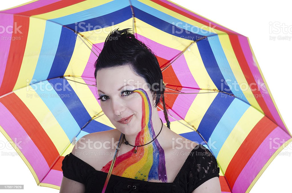 Woman in rainbow makeup with umbrella on white. royalty-free stock photo