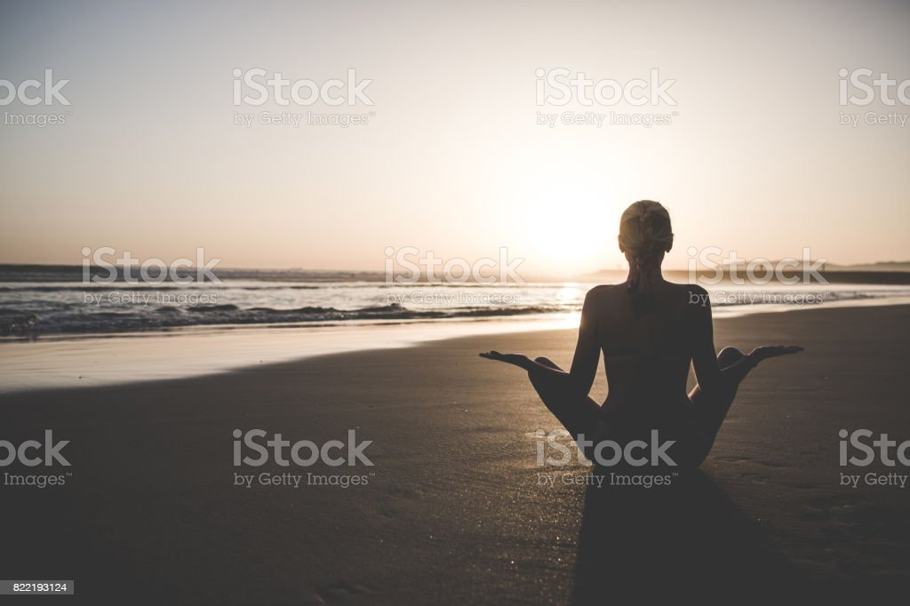 Woman in real life, make yoga and relaxing outdoors stock photo