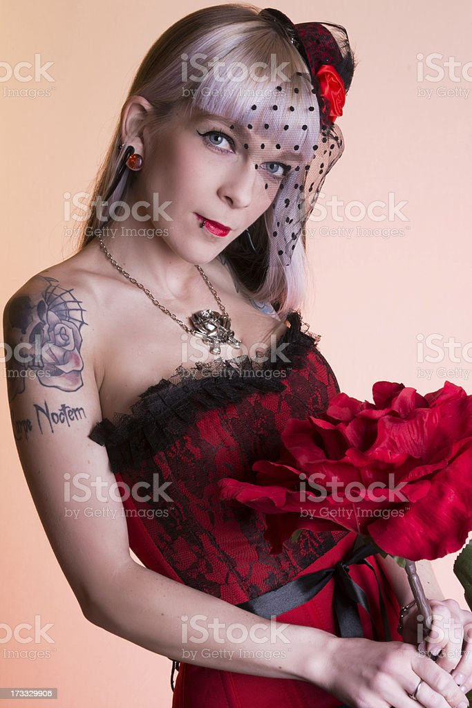 Woman in red and black on pale orange background. royalty-free stock photo
