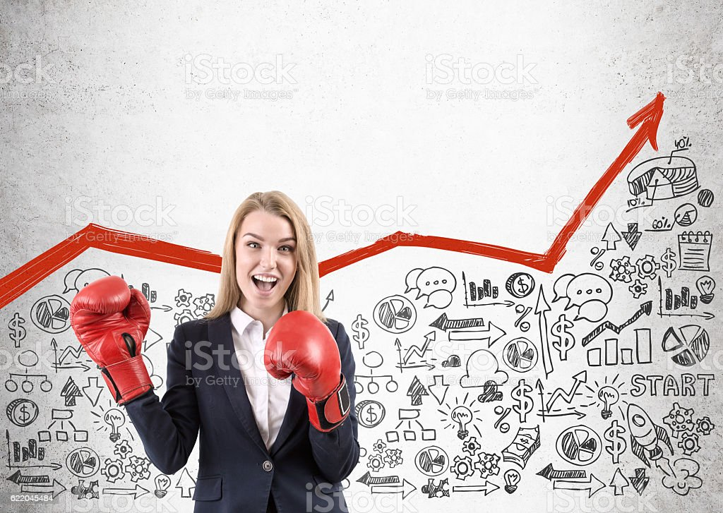 Woman in red boxing gloves stock photo
