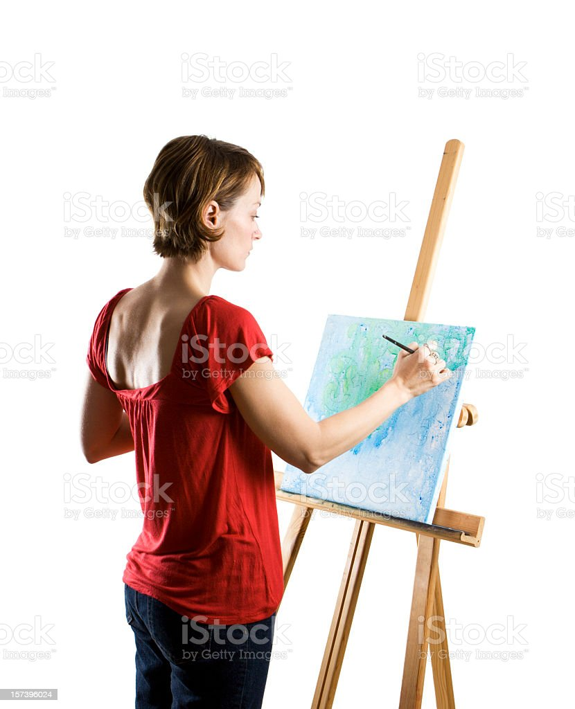 Woman in red busy painting artwork in white studio royalty-free stock photo