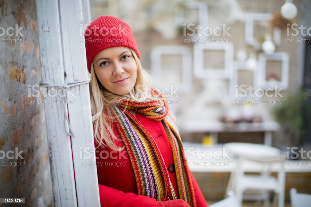 Woman in red coat stock photo