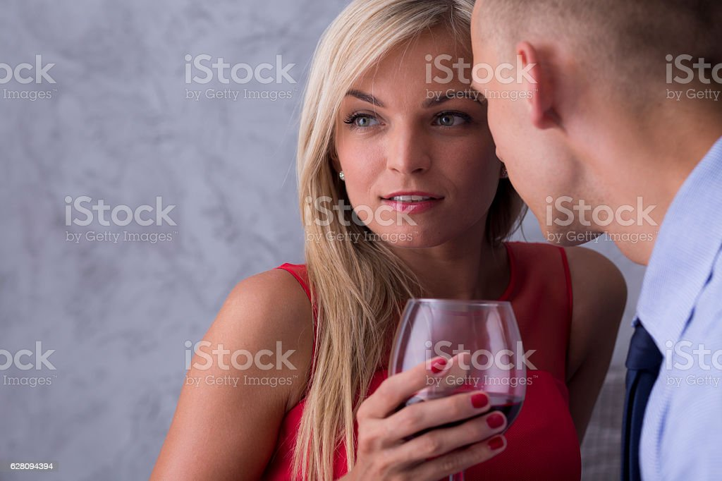Woman in red dress and boyfriend stock photo