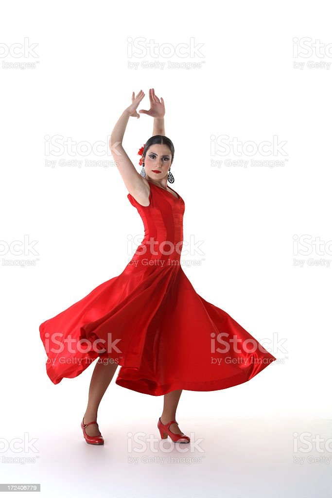 Woman in red dress and shoes in Flamenco dance pose stock photo