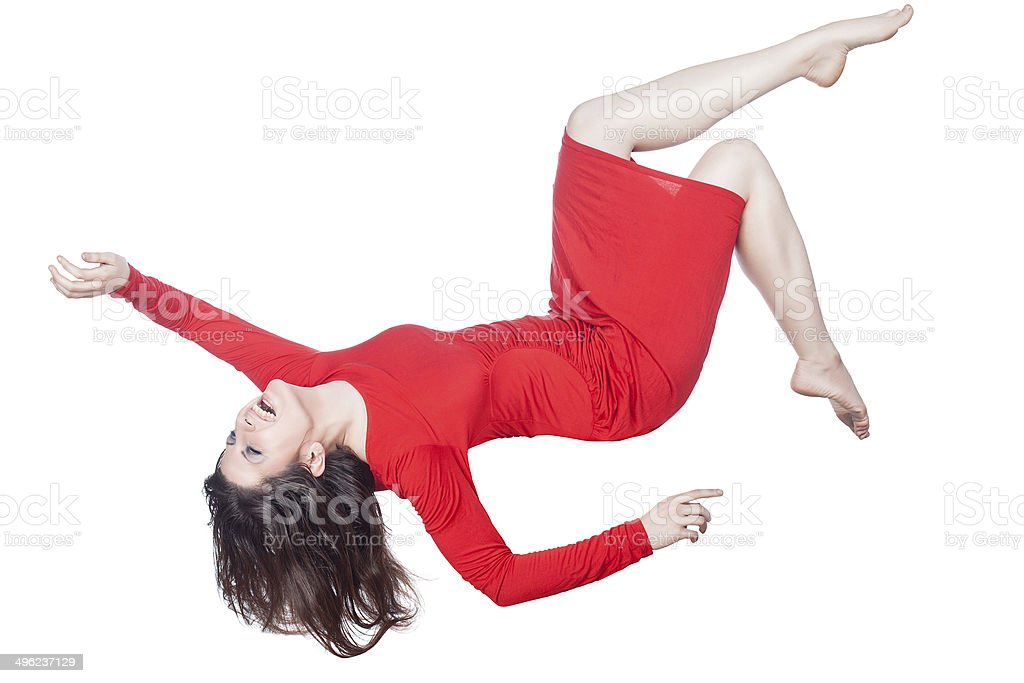 Woman in red dress falls. stock photo