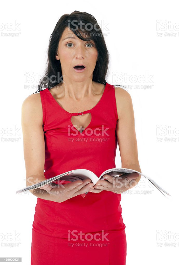 woman in red dress holding a magazin stock photo