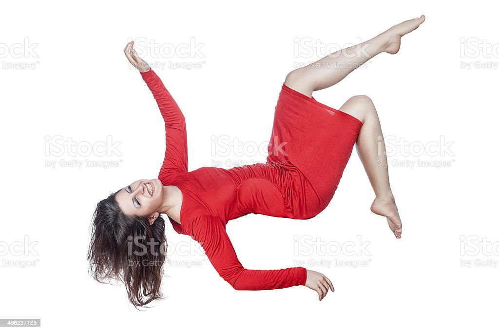 Woman in red dress laughs and falls. royalty-free stock photo