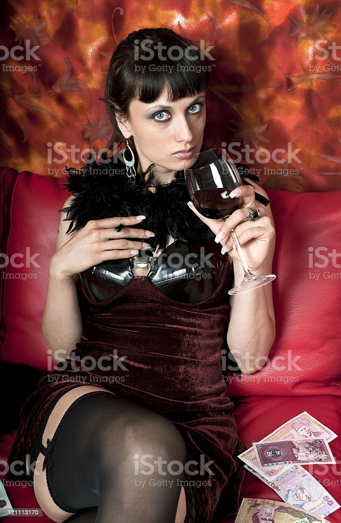 Woman in Red Drinking Wine royalty-free stock photo