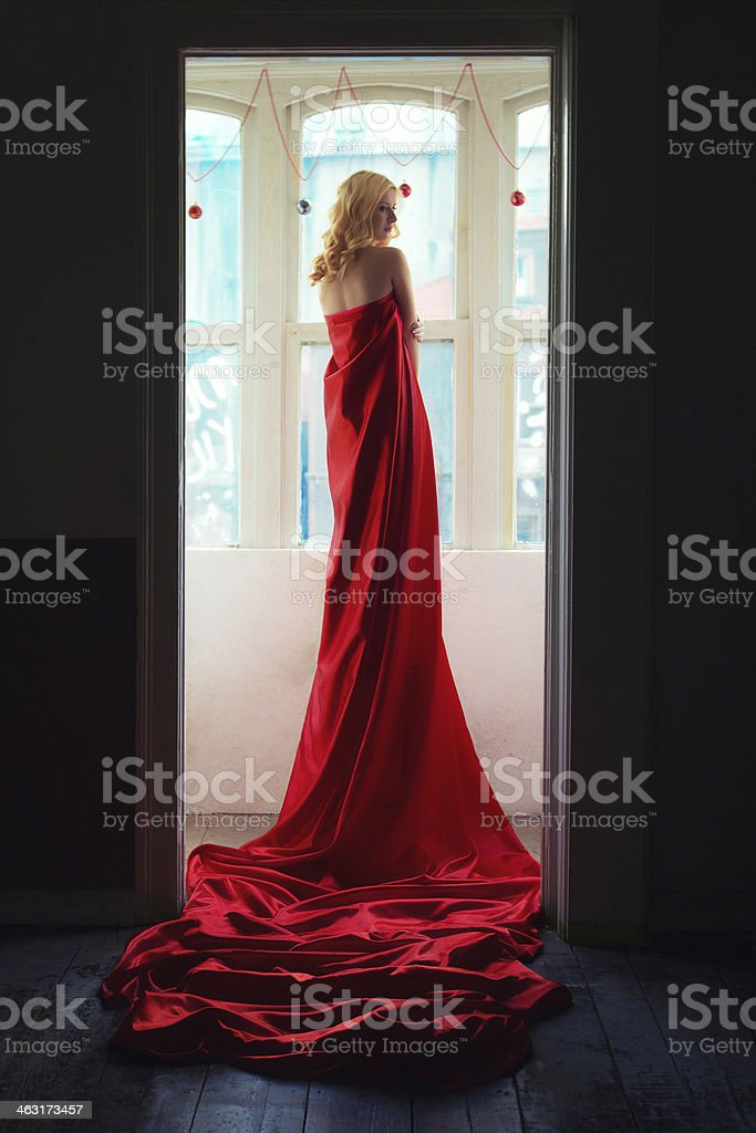 Woman in red fabric stock photo
