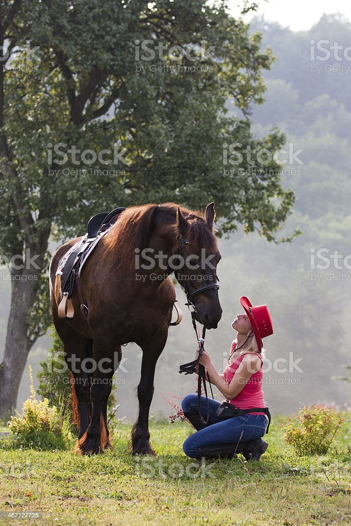 Woman in red hat riding royalty-free stock photo