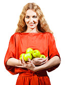 Woman in red holding apples her hands
