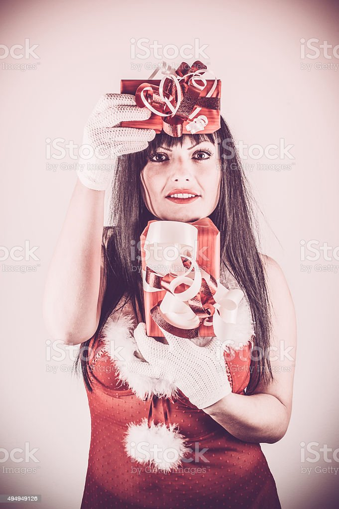 Woman in Red Lingerie holding Christmas Presents stock photo