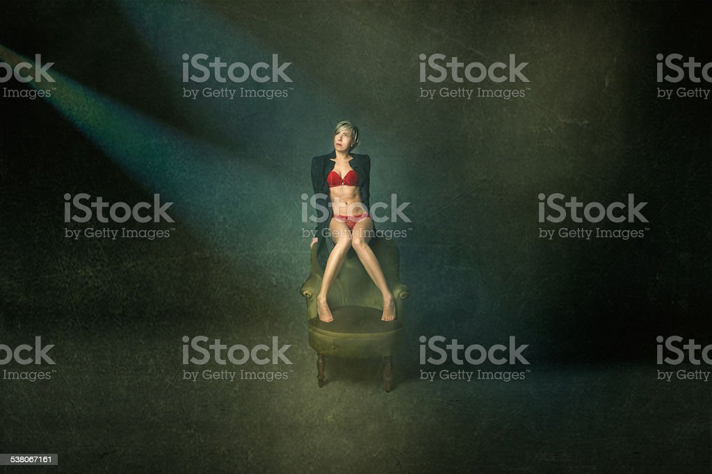 woman in red lingerie like a celebrities under lights stock photo