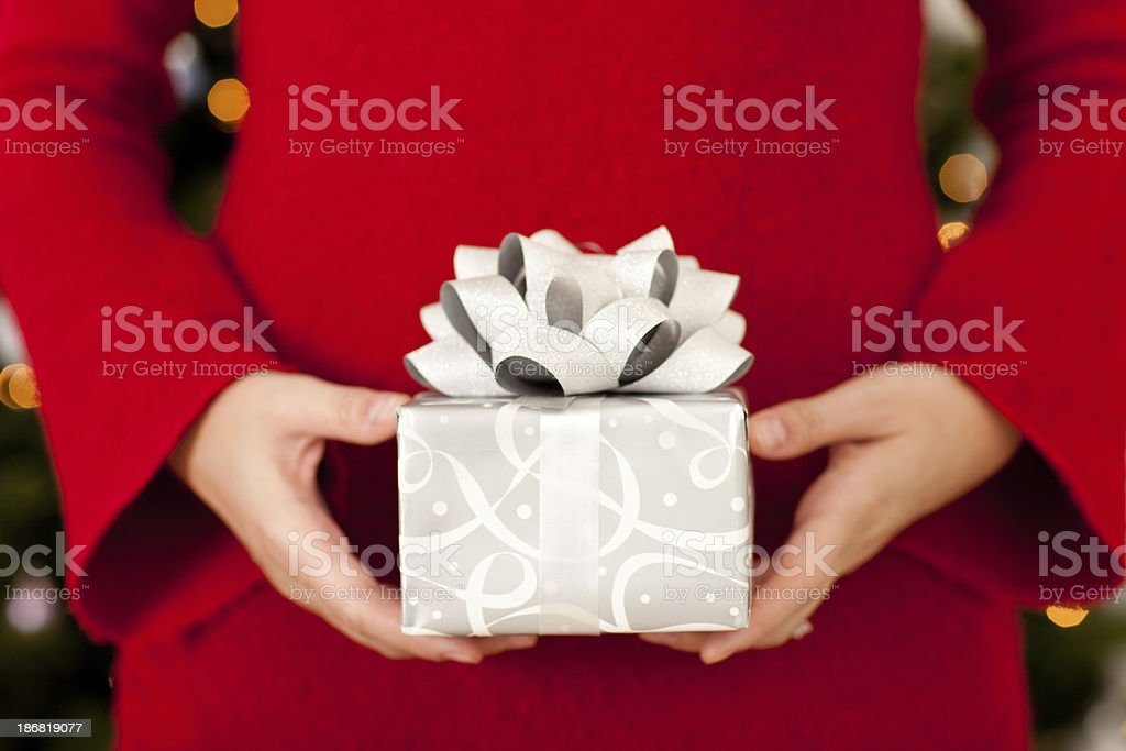 Woman in Red Sweater Holding Christmas Gift royalty-free stock photo