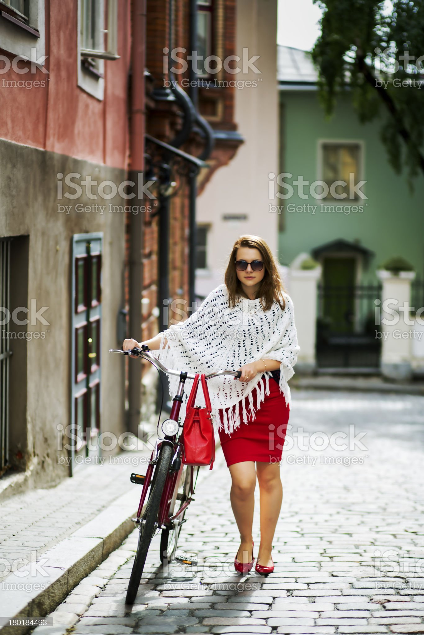Woman in red walking on street royalty-free stock photo
