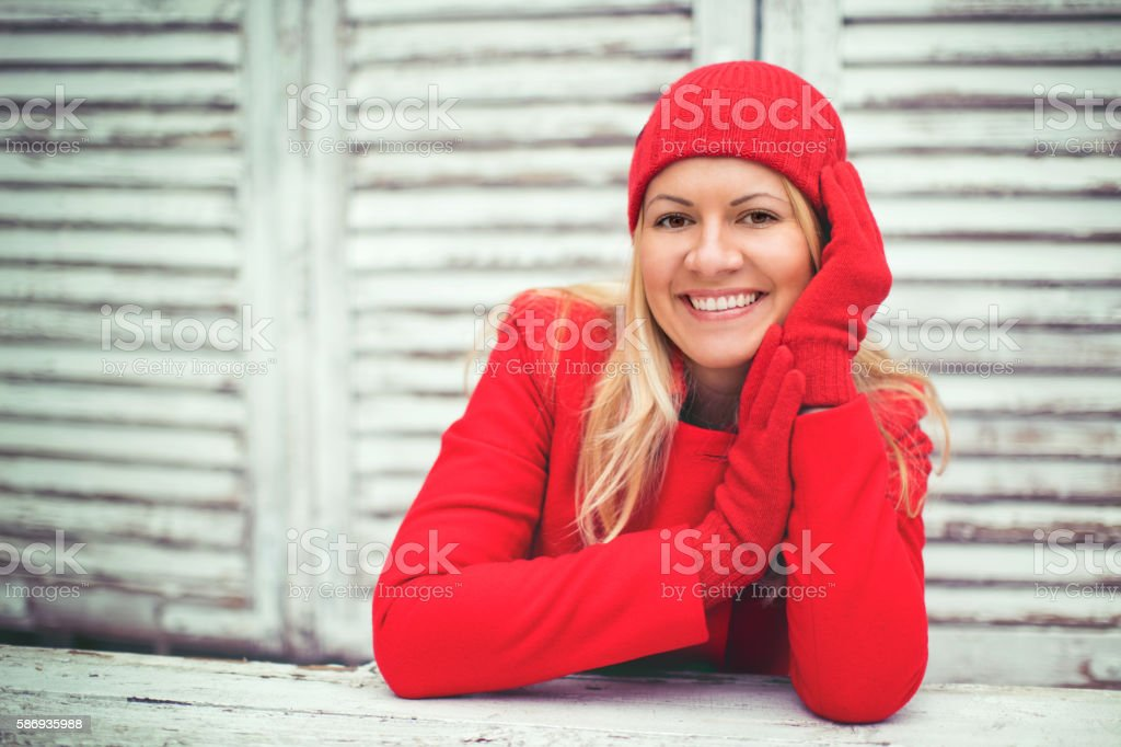 Woman in red warm coat stock photo