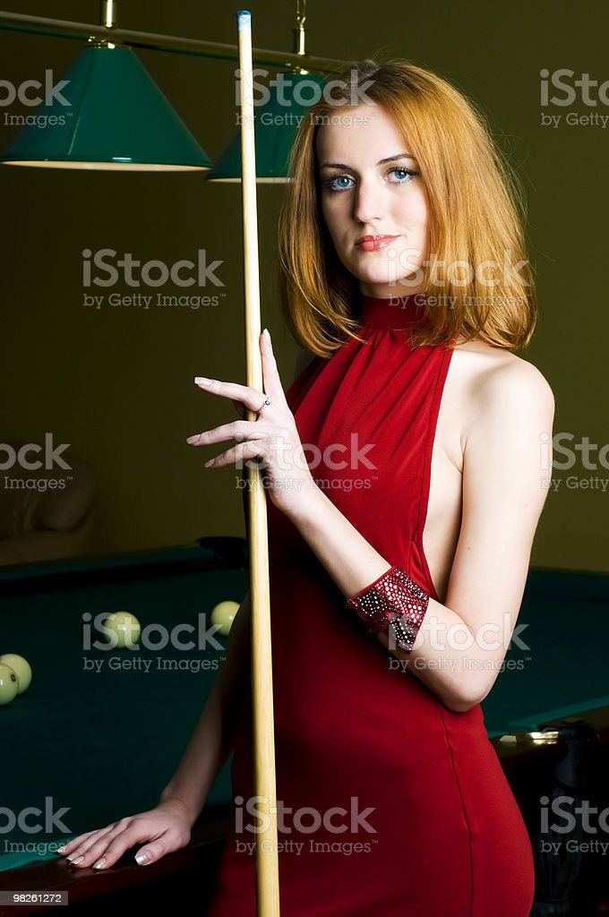 Woman in red with cue stock photo