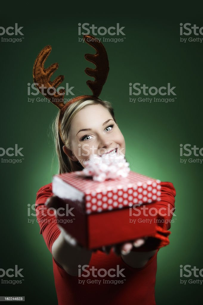 Woman in reindeer costume christmas time royalty-free stock photo