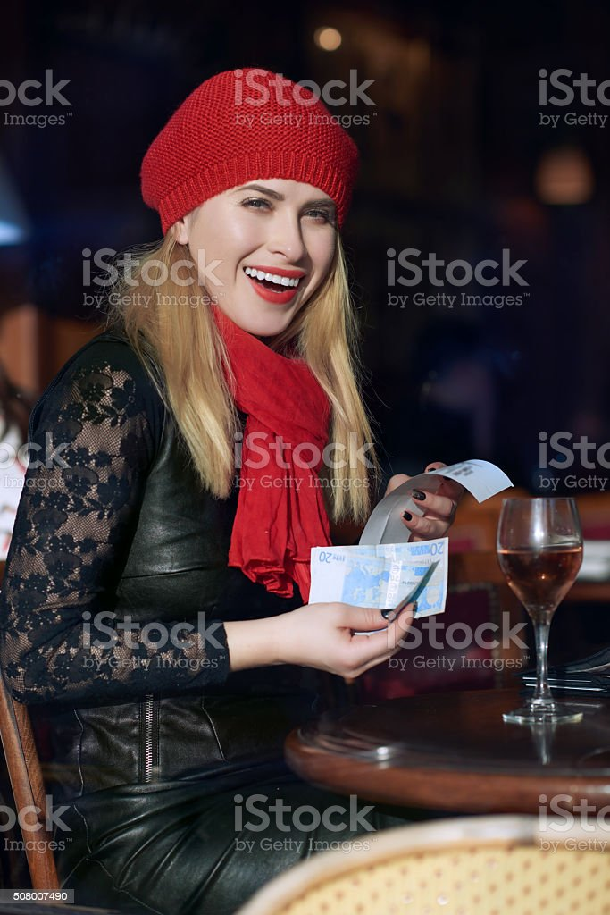 woman in restaurant paying the bill stock photo