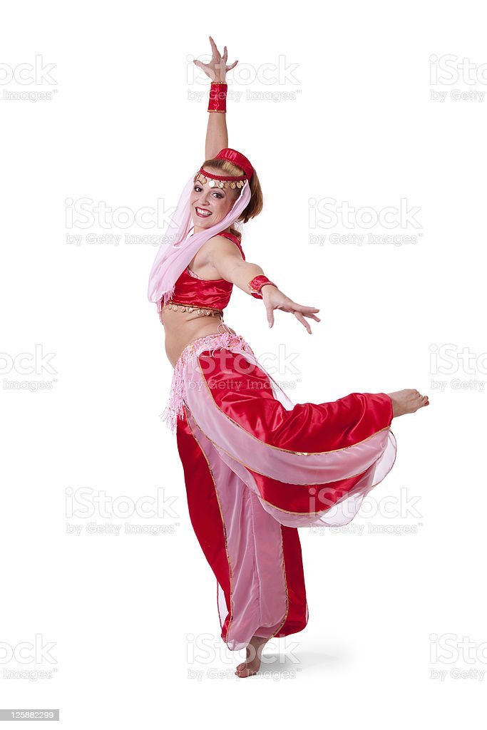 Woman in retro belly dance costume making an arabesque stock photo