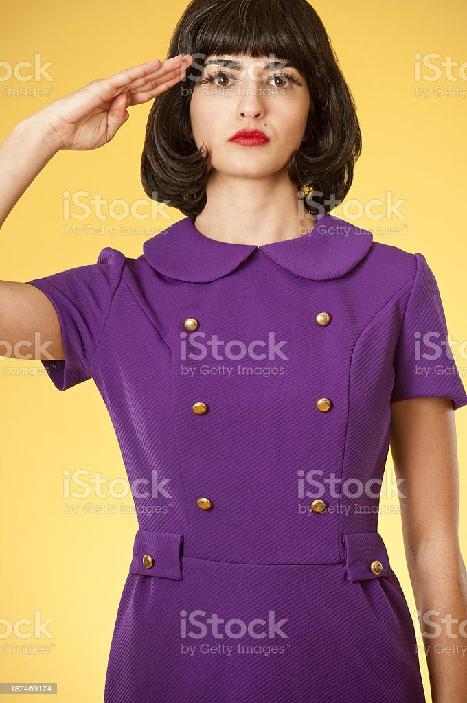 Woman In Retro Dress Saluting royalty-free stock photo