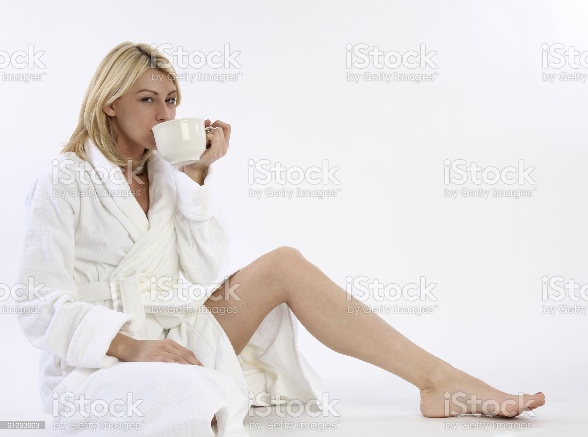 Woman in robe drinking coffee royalty-free stock photo