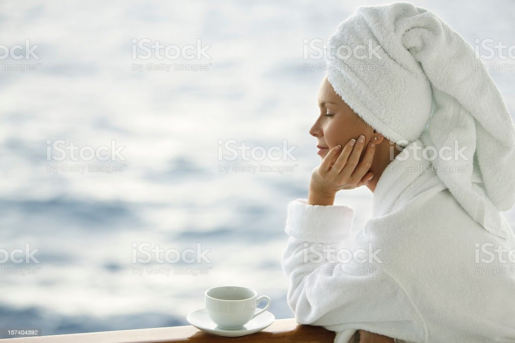 woman in robe with coffee stock photo