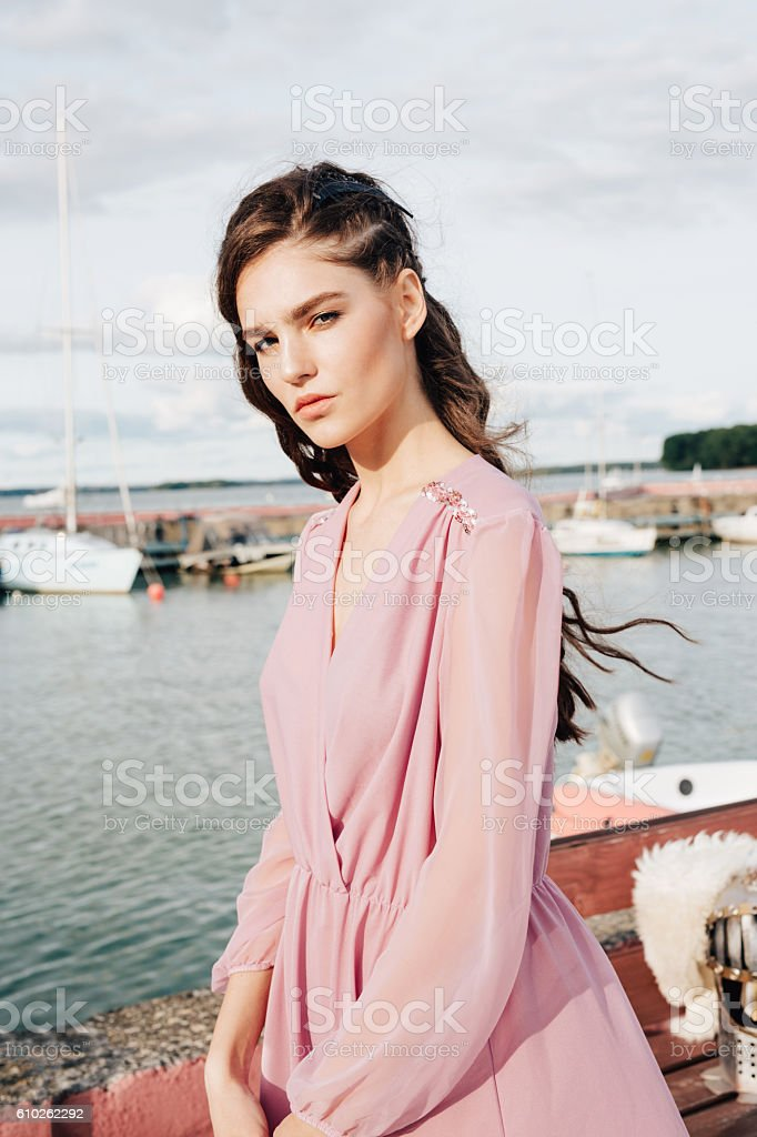woman in romantic pink dress with curl hair stock photo