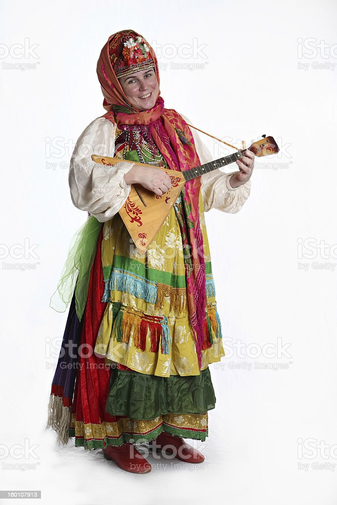 Woman in Russian costume playing instrument stock photo