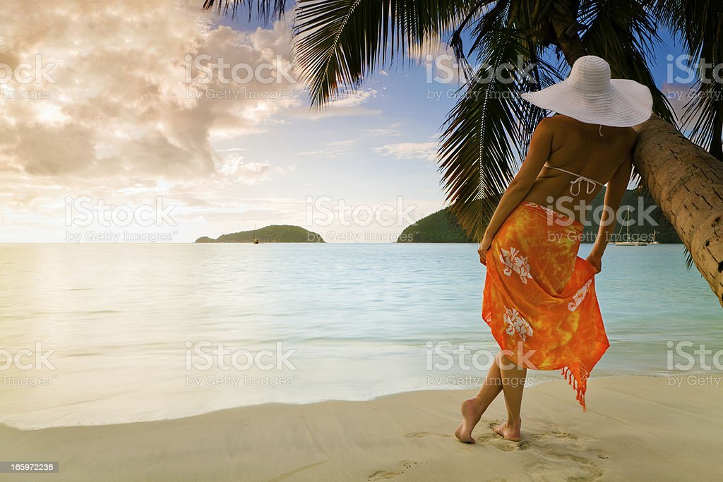woman in sarong and hat enjoying the Caribbean view royalty-free stock photo