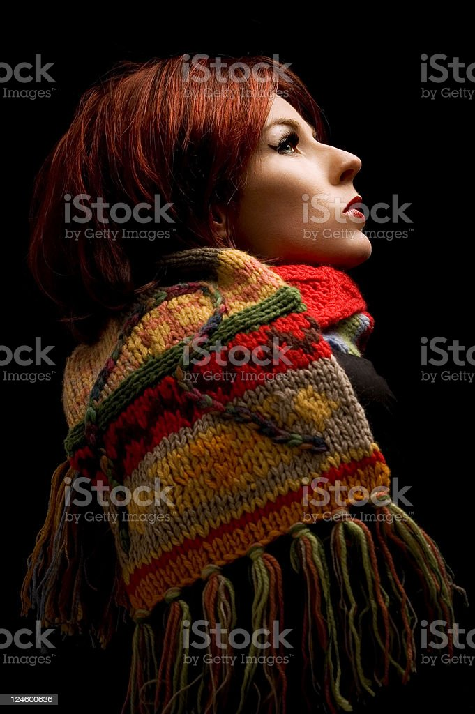 Woman In Scarf on Black Background stock photo