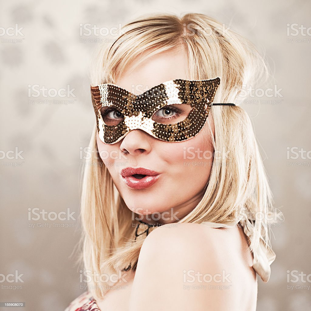 Woman in sequin disguise stock photo