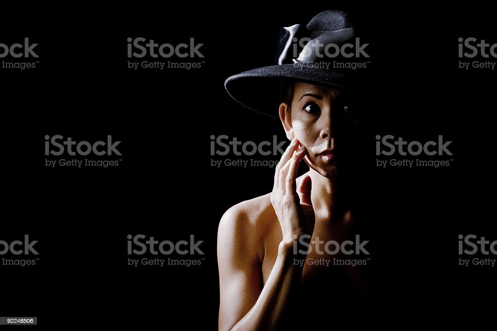 Woman in shadow wearing a black hat royalty-free stock photo