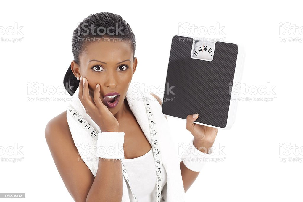 Woman in shock after losing weight. royalty-free stock photo