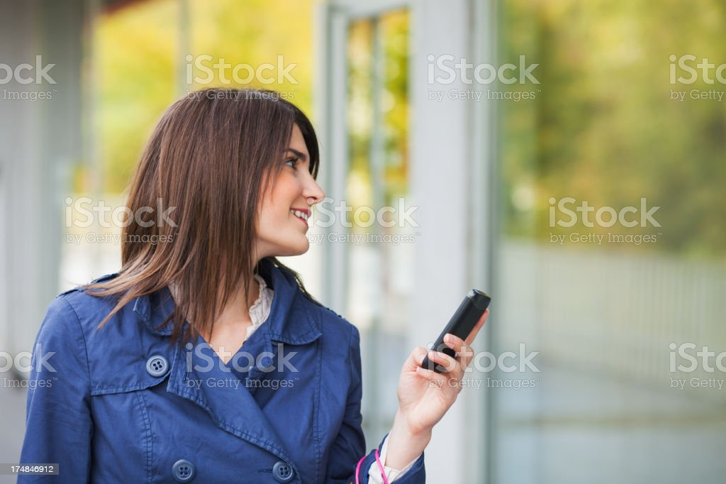 Woman in shopping with mobile phone royalty-free stock photo