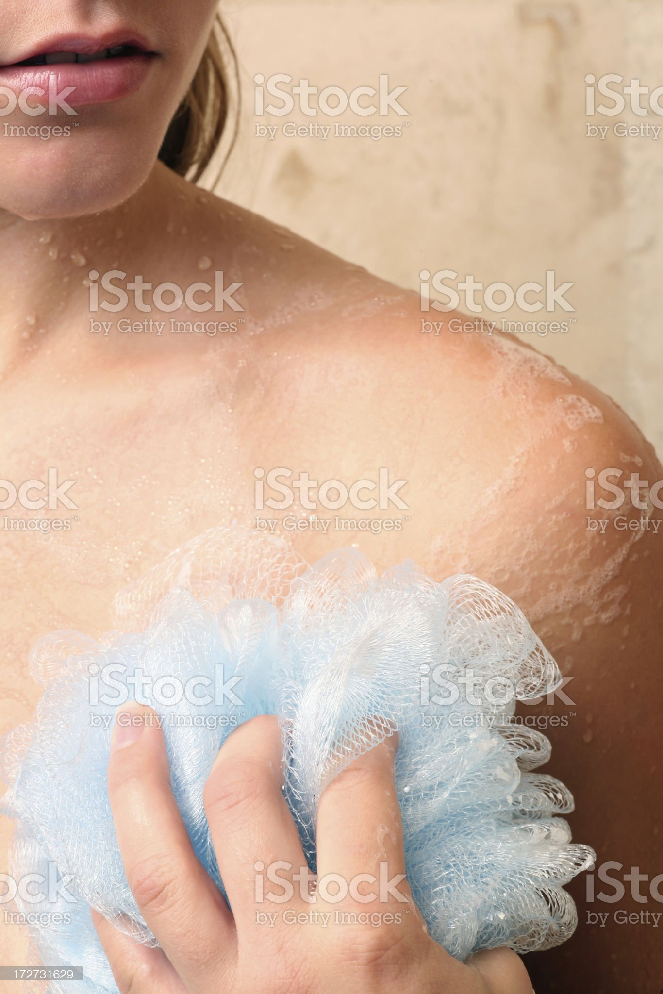 Woman in shower scrubbing clean and Exfoliating royalty-free stock photo