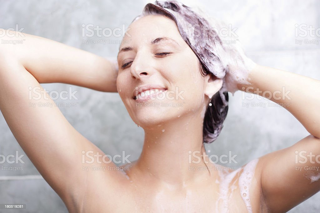 woman in shower washing hair stock photo
