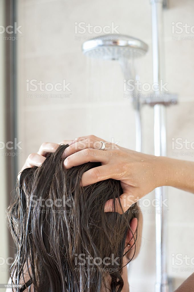 Woman in Shower Washing her Hair stock photo