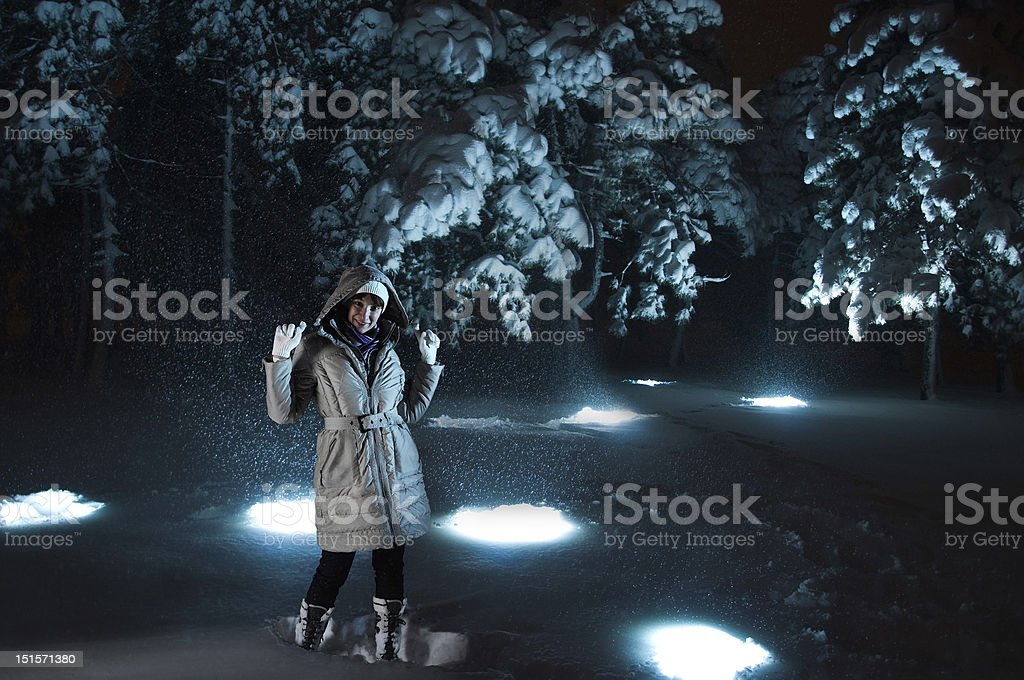 Woman in snow with blue lights stock photo