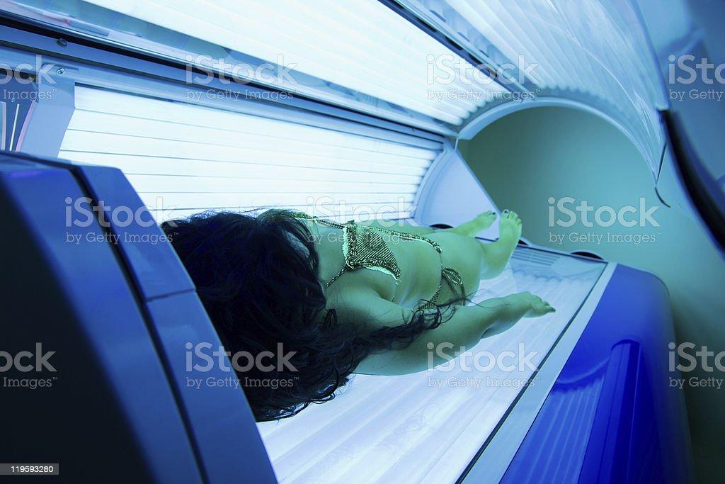 Woman in solarium stock photo