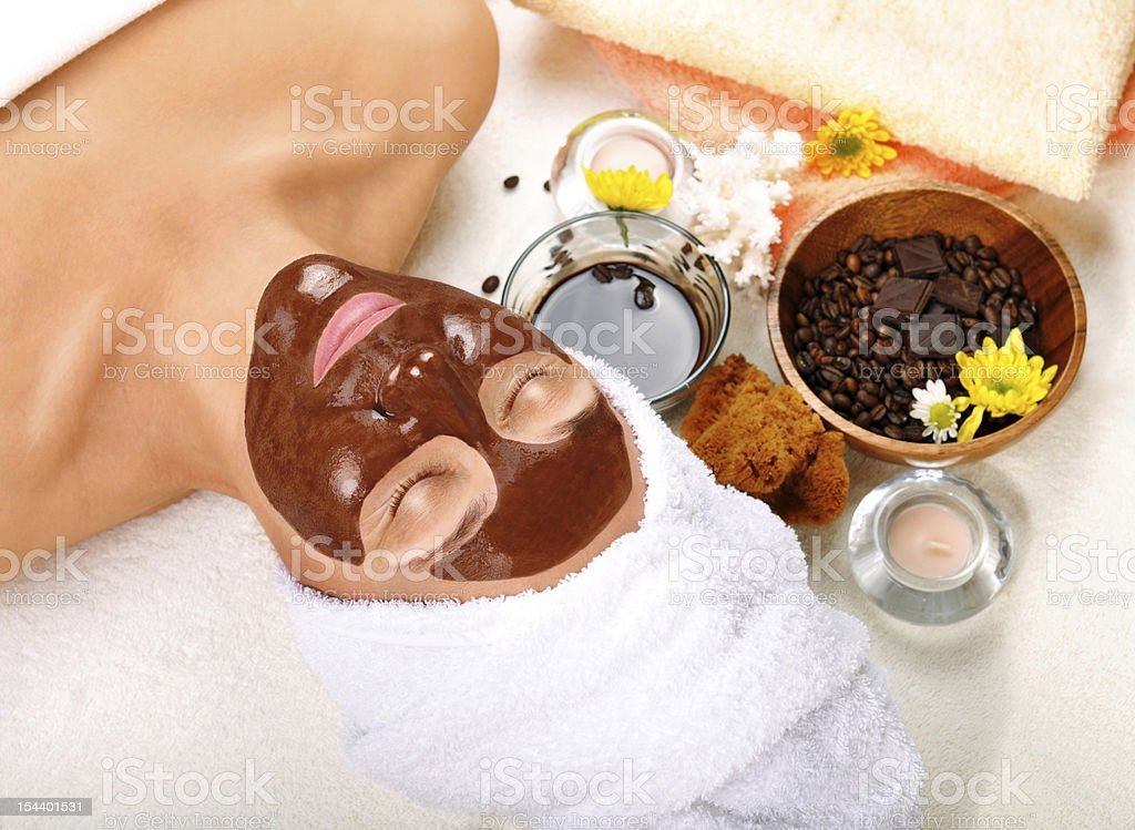 Woman in spa atmosphere receiving a chocolate facial royalty-free stock photo