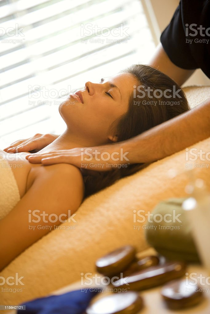 Woman in Spa Receiving Massage royalty-free stock photo