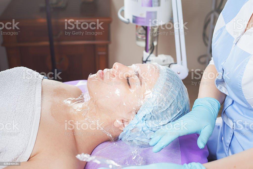 Woman in spa salon receive skin treatment. stock photo