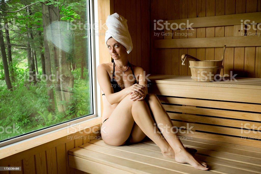 Woman in spa sauna. stock photo