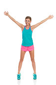 Woman In Sport Clothes Standing With Arms Outstretched