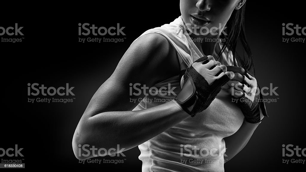 Black and white close up portrait of fitness athletic young woman in...