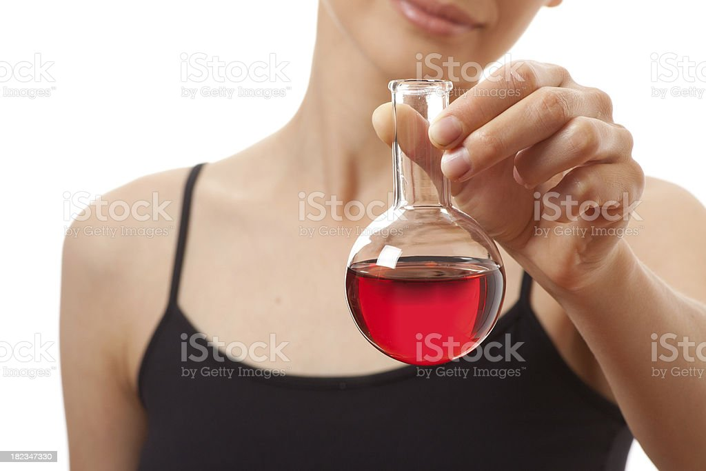 woman in sports suit holds flask with  red liquid stock photo