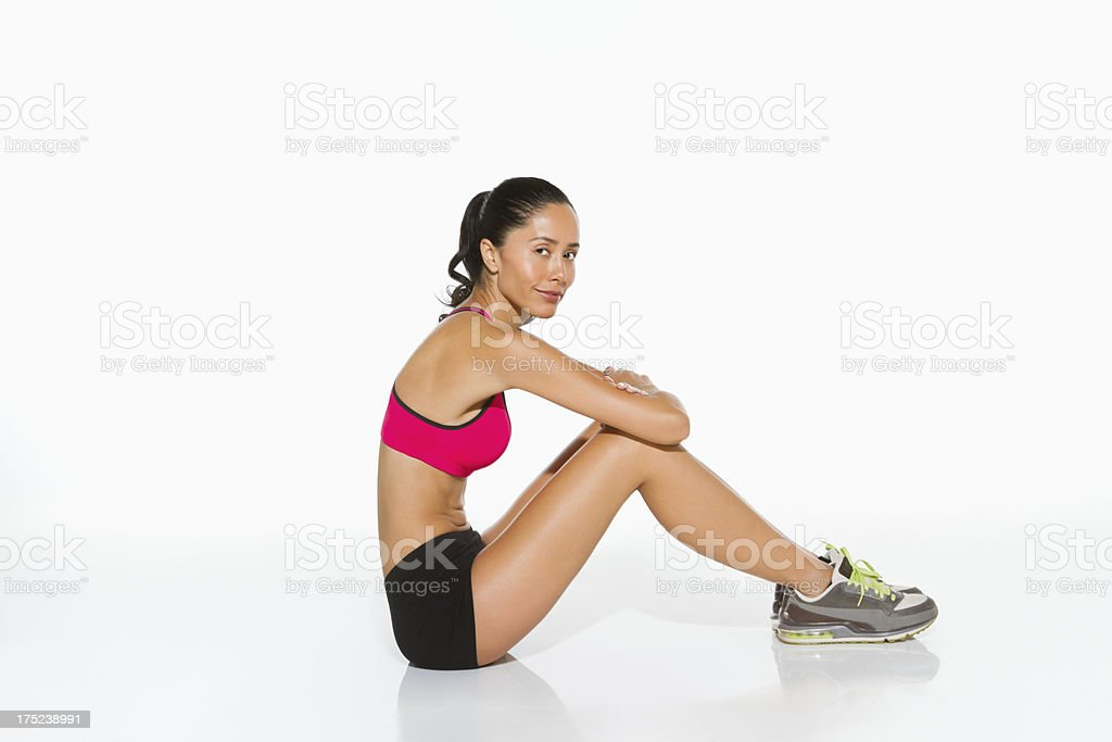 Woman In Sportswear Siting On Floor royalty-free stock photo